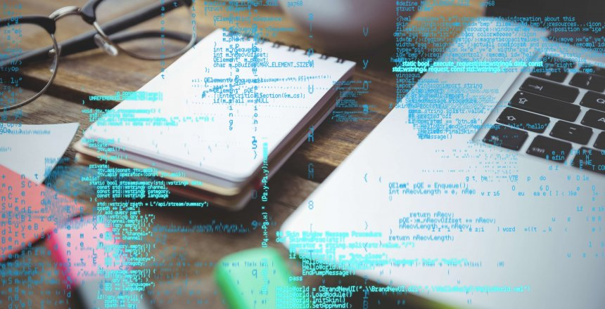 digital composite of laptop with notepad and coffee on table with graphics